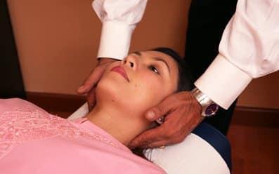 good chiropractor adjusting neck of female patient